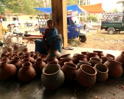 Buy earthen pots from local villagers at weekly fair