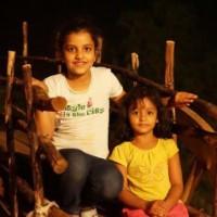 Kids portraits on bullockcart