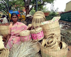 lady selling cane artifatcs brooms which are highly eco products
