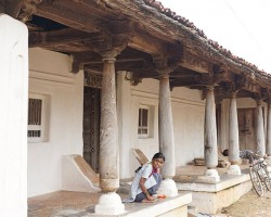 Old houses with multiple pillars around eco friendly resort