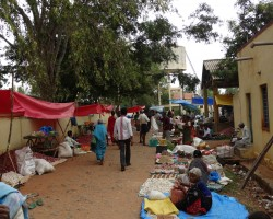 Villagers buy sell in weekly market